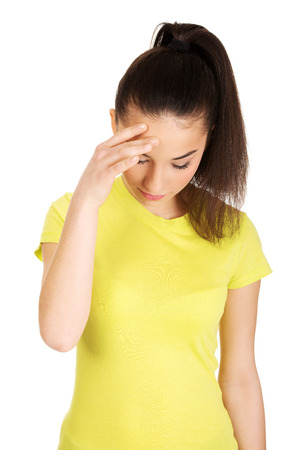 holding on head: Teen woman with a headache holding head.