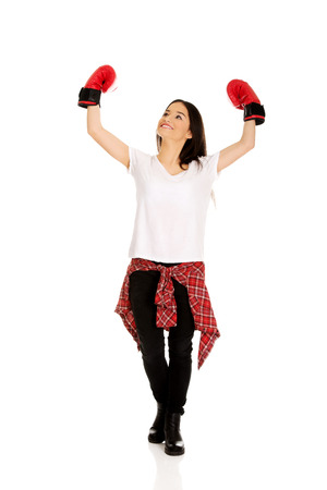 Young teenage woman wearing boxing gloves. photo