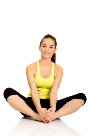 warm up exercise: Young fitness woman in warm up exercise.