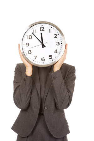 covering the face: Business woman covering face with clock. Stock Photo