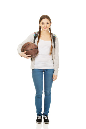 schoolbag: Teenager with schoolbag and basket ball. Stock Photo