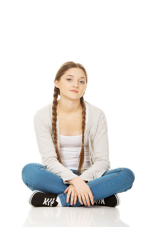 beautiful teen: Beautiful teen woman sitting cross legged.