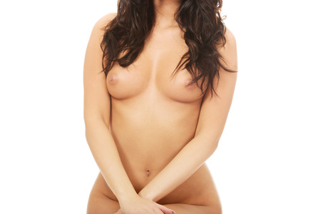 breast beauty: Beautiful woman showing her naked breast. Stock Photo