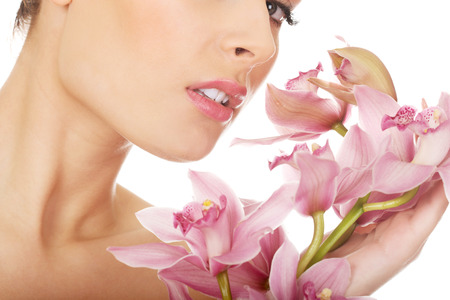 Young beautiful woman with pink flower. photo