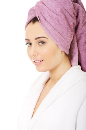 woman bathrobe: Beautiful spa woman in bathrobe and turban.