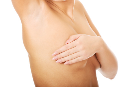 anatomy naked woman: Woman examining breast mastopathy or cancer.