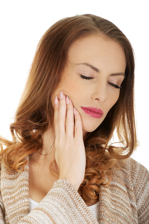 tooth ache: Woman suffering from tooth ache.