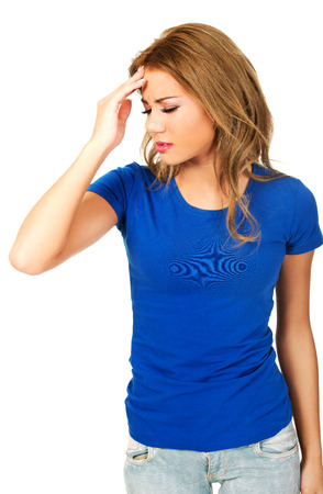 complications: Beautiful young woman with headache touching her head. Stock Photo