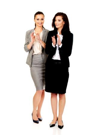 applauding: Two happy cheerful businesswomen applauding. Stock Photo