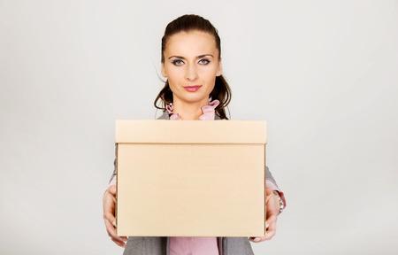loosing: Sad businesswoman carrying box after loosing job. Stock Photo