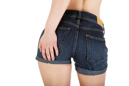 ass jeans: Sexy woman body in jeans shorts. Stock Photo