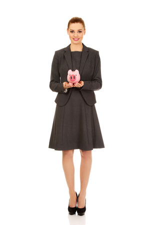 piggybank: Happy business woman with piggybank. Stock Photo