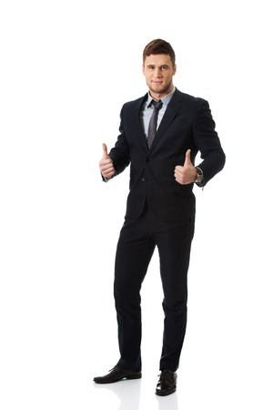 thumbsup: Happy handsome smiling businessman with thumbs up gesture. Stock Photo