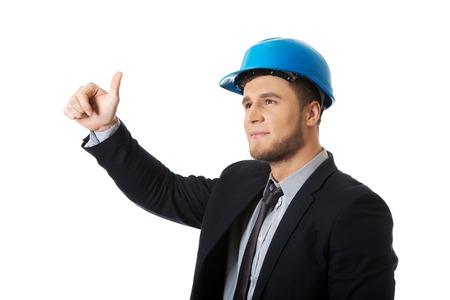 ok: Happy handsome businessman in helmet showing ok sign. Stock Photo