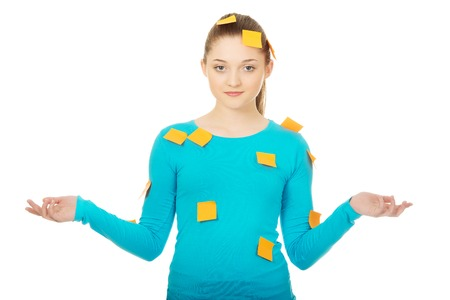 post it notes: Beautiful young woman covered with post it notes. Stock Photo
