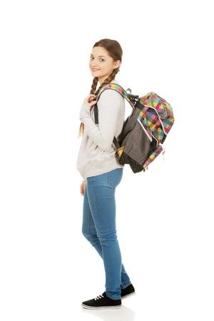 beautiful teen: Happy beautiful teen woman with backpack.