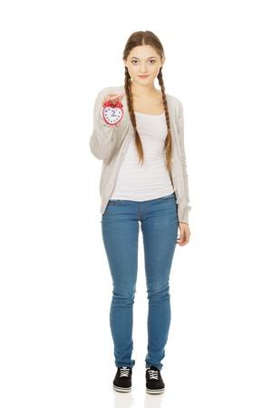 alarmclock: Beautiful teenage woman with alarmclock.