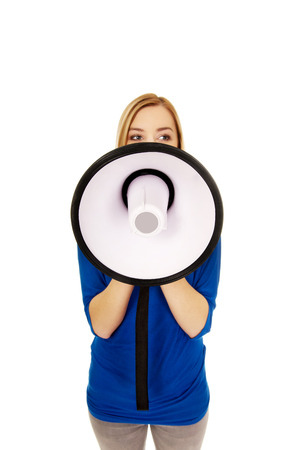 annoucement: Young woman shouting with a megaphone.