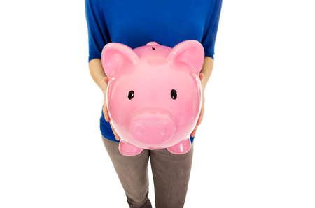 piggybank: Casual woman holding a piggybank.