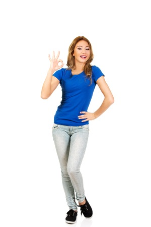 perfect sign: Casual young woman showing perfect sign. Stock Photo