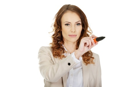 oversized: Attractive businesswoman writing with oversized pen.