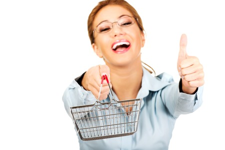 thumbs up business: Young businesswoman with shopping cart and thumbs up. Stock Photo
