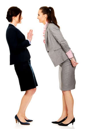 25 30 years women: Two angry businesswomans arguing with eachother.