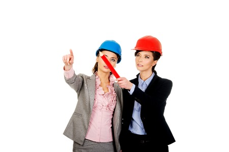 executive helmet: Two attractive architects women talking. Stock Photo