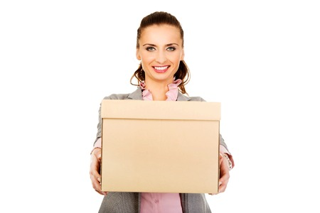 carrying box: Sad businesswoman carrying box after loosing job. Stock Photo