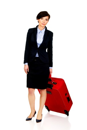 hapy: Happy smiling businesswoman with suitcase.
