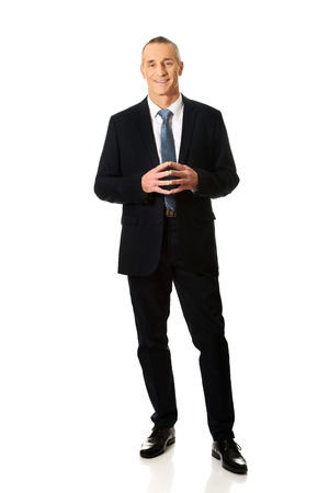 full length: Full length confident businessman with clenched hands. Stock Photo