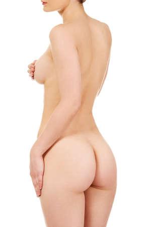 nude female buttocks: Beautiful naked woman back to camera.