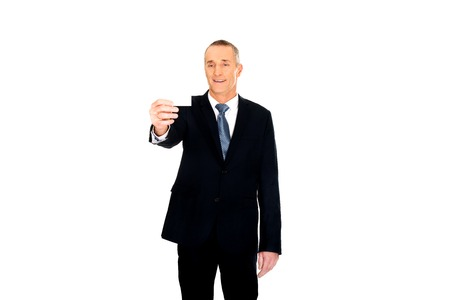 cardkey: Businessman showing a blank identity name card. Stock Photo