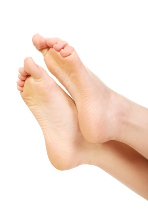 foot spa: Healthy smooth female bare feet.