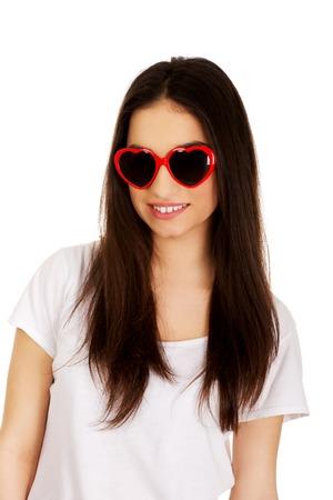 Teenage woman wearing heart sunglasses. photo