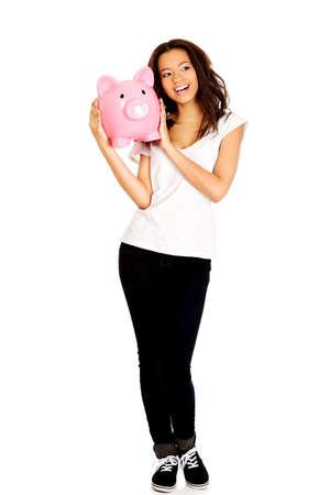 piggybank: Happy african woman with piggybank. Stock Photo