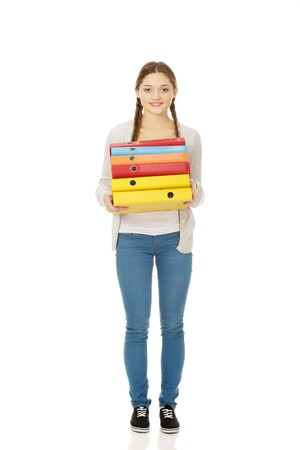 binders: Happy teen woman holding binders.