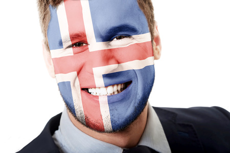 iceland flag: Happy man with Iceland flag painted on face.