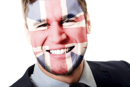 great britain flag: Happy man with Great Britain flag painted on face.