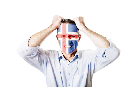 iceland flag: Mature man with Iceland flag painted on face.