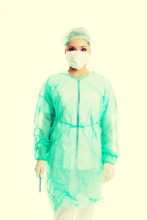 Female surgeon doctor with a scalpel. photo