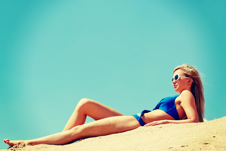 full length woman: Full length woman lying on the beach. Stock Photo