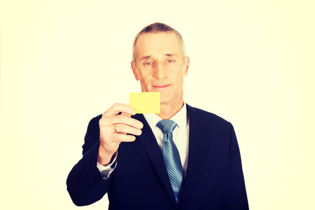 cardkey: Businessman showing a yellow identity name card.