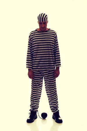 prisoner ball: Mature sad man prisoner criminal with chain ball.