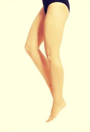 bare ass: Woman slim legs in black panties Stock Photo