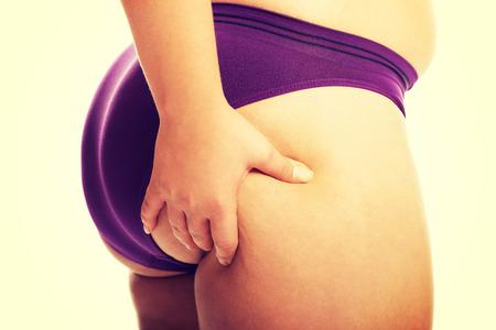 big ass: Overweight woman checking her fat.