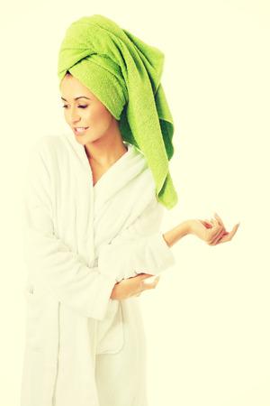 woman bathrobe: Happy spa woman in bathrobe looking down. Stock Photo