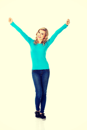 full length woman: Full length woman making winner gesture. Stock Photo