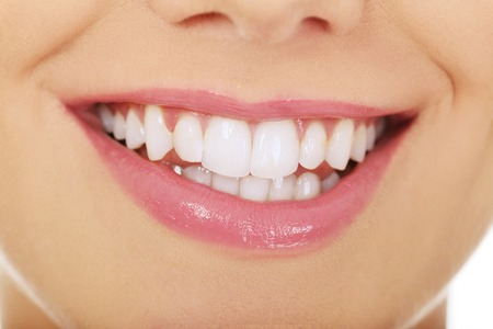 teeth whitening: Beautiful young woman toothy smile. Stock Photo