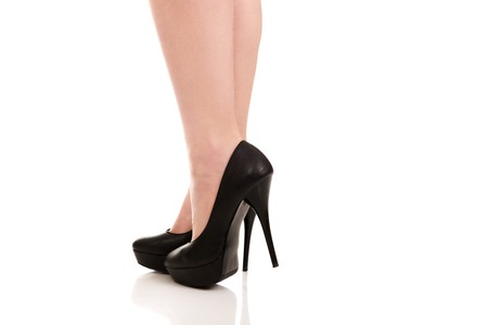 Woman legs with black sexy high heels.